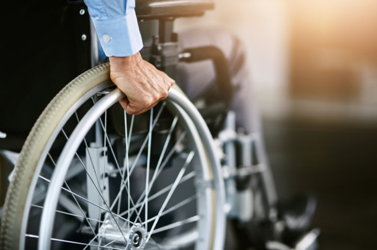 Worker in a wheelchair receiving disability.