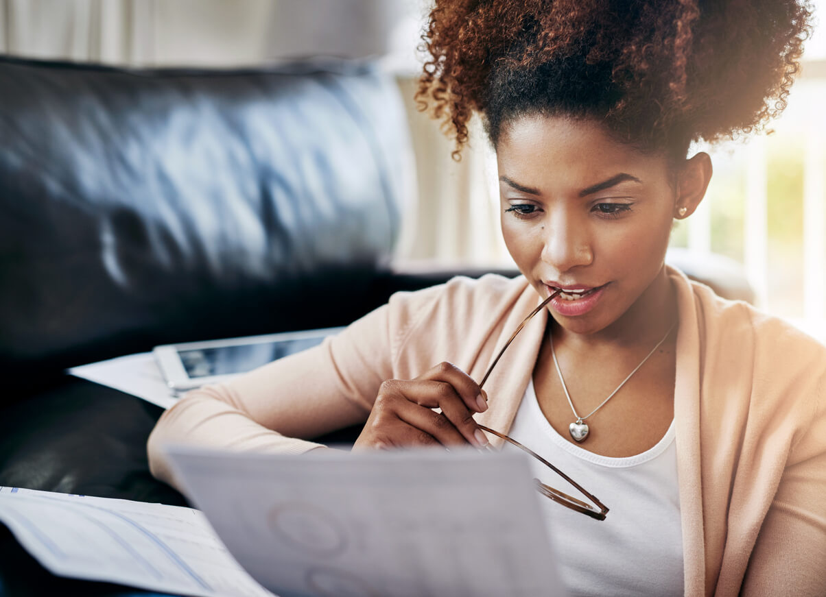 woman looking at papers with glasses